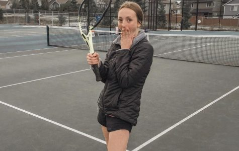 Student, Lauren Tomich posing for a photo at Tahoma High School tennis court before practice.
