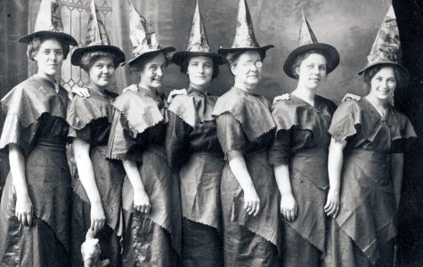 A group of women dress up as witches in the early 1910s.